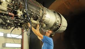aircraft engine mechanic lee peyton inspects an f414 ge 400 turbofan engine the turbine engine mechanic