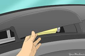 how to replace a door lock relay yourmechanic advice hand removing the panel above the glove box