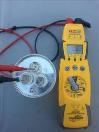 start and run capacitor explained hvac how to this test is being done on a dual run capacitor 55 5 mfd uf the multi meter is on farads and the leads are on c and fan positive and negative do not