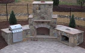 stone faced outdoor corner fireplace with built in grill