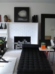 inspiration for a modern living room remodel in los angeles with white walls and a standard