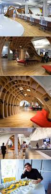 futuristic office ditches cubicles for a super desk that seats 125 employees techeblog base group creative office