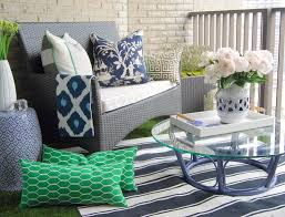 mesmerizing small balcony design with outdoor wicker furniture chair plus round glass table and colorful throw pillows