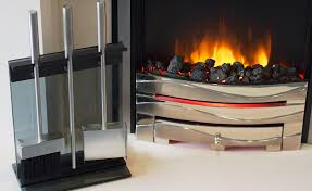 an electric fire with companion set