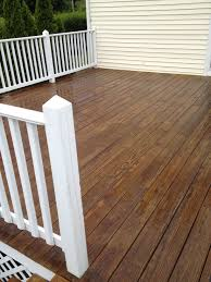 Pressure treated wood decking and white painted trim, New England ...