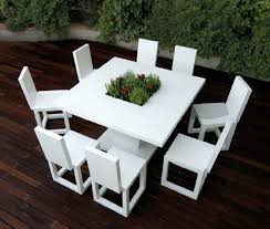 modern white outdoor tables and chairs. casual model for modern patio furniture on wooden floor and white color plus amusing centerpiece outdoor tables chairs n
