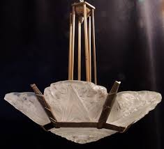 a wonderful art deco bronze chandelier with beautiful molded frosted glass decorated with both linear and