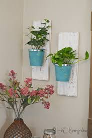 easy tutorial for diy wall hanging planters using dollar items i made a set