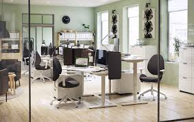 Office ikea Diy An Office Environment In White Grey And Green With Corner Desks Adjusted To Different Heights Ikea Ikea For Business Ikea