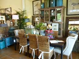interesting dining room design presented with several wicker woven dining room chairs which have white ribbons also two white wingback chairs in diffe