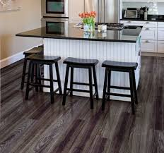 Vinyl Plank Flooring Kitchen Black Oak Allure Vinyl Plank Flooring Matched With Cream Wall Plus