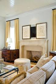 hide tv over fireplace how to above the framed paintings on sliding rails and hiding wires hide tv over fireplace