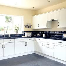 black and white kitchen pros cons of pearl granite home cabinet quartz countertops