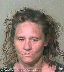Busted: Authorities arrested Robert Allen Smith, 35, left, and Larinda Austin, 47, right, after finding a meth lab in the couple's Harrah, Oklahoma house - article-2152149-135E24B9000005DC-313_306x345
