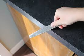 file edges the edges of your freshly cut laminate will be sharp so file them down with a metal file at a 45 degree angle
