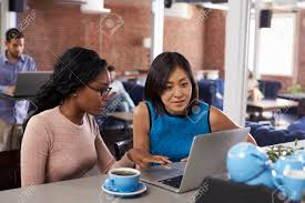 office coffee bar. Stock Photo - Two Businesswomen Have Informal Meeting In Office Coffee Bar