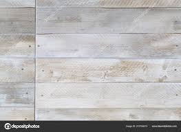 closeup of porcelain floor tiles with wood plank floorboard effect texture pattern photo by paulmaguire