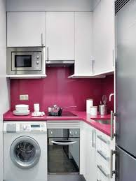 Like the splash back in different colour and the microwave. smart small  kitchen design idea for apartment or small house