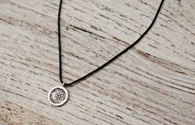 small om necklace on black cord
