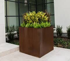 Cor ten steel Steel Plates 45 Inch Tall Corten Steel Planter On Limestone Patio Planter Has Green Pinterest Custom And Standard Steel Planters Bentintoshapenet Made In The Usa