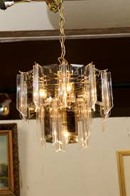vintage two tier waterfall chandelier of brass having lucite pendants separated by beveled smoked glass prisms