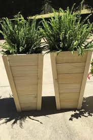 this tall tzoid planter is such a casual and cool look its vertical silhouette gets a fun twist when finished in a pastel color the best part