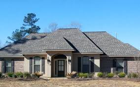 luxury stucco house plans and pour architectural style features a symmetrical stucco and brick exterior and
