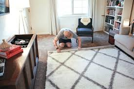 area rug over carpet in living room do area rugs work over carpet o