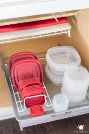 rubbermaid food storage containers organized in the kitchen cabinets