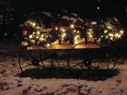 cart hold boughs of fir bedecked with ribbons and white lights photo missouri