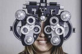 happy woman having eye exam in wildomar