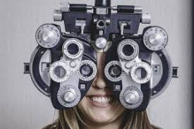 happy woman having eye exam in wildomar