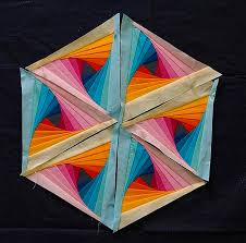 triangle template, do it right and it makes striking flowers! This ... & Twisted Log Cabin in Pastels - An Inspirational Sunday Post Adamdwight.com