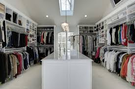 big walk in closet with skylight window and center island