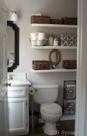 cabinets over toilet in bathroom. open floating shelves over the toilet for bathroom storage cabinets in
