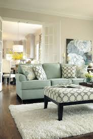 Living Room Decor-love the couch color and shape, plus the ottoman!