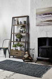 industrial looking furniture. looking for some living room inspiration mix natural rustic furniture with cool coloured accessories industrial