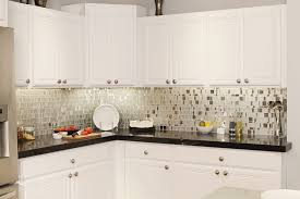 glass windows and cream wall white cabinets black countertops what color floor by mocha tile backsplash