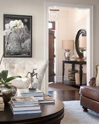 contemporary entry table living room traditional with pendant light dark wood door coffee table books