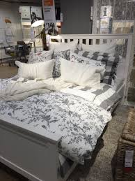 IKEA Hemnes bed for guest bedroom - love the grey and floral. Looks so cozy