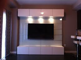 Small Picture modern bedroom wall units ideas with led lighting above tv units