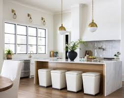 marble waterfall countertop in kitchen with a wood inlay