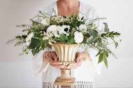 holding gold vase green white flowers shako florist jpg