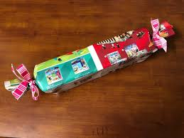 using toy catalog pages as gift wrap
