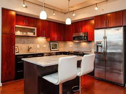 modern kitchen with cherry wood cabinets and wood floors