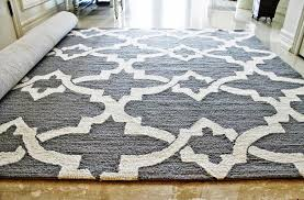 image of pictures of area rugs over carpet