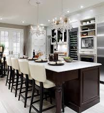 you can also opt for one stand out chandelier to make a bold statement in your kitchen