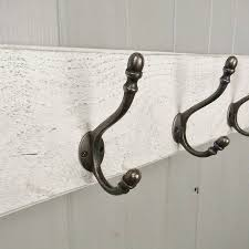 reclaimed wood coat hook board by potting shed designs