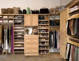 furniture high brown wooden shoes closet with storage and drawers on the middle feat hanging