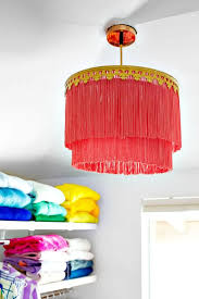 brighten up your particular room interiors also with this handcrafted fringe chandelier that is really looking eye catching and beautiful